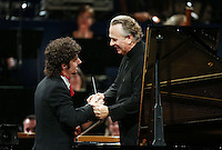 PICTURE BY VAUGHN RIDLEY/SWPIX.COM - Leeds International Piano Competition 2012 - Leeds Town Hall, Leeds, England - 15/09/12 - Federico Colli of Italy is congratulated by Sir Mark Elder.