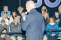 People listen as Democratic presidential candidate and former Vice President Joe Biden speaks at a campaign event at The Sports Barn in Hampton, New Hampshire, on Sun., December 8, 2019.