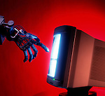 metaphorical illustration of robotic hand reaching to touch interactive computer screen