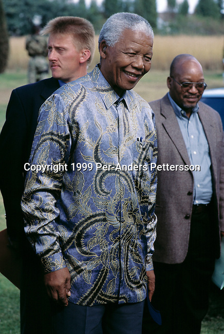 EASTCOURT, SOUTH AFRICA - MAY 1: Former President Nelson Mandela of South Africa smiles as he greets school children during a election stop on May 1, 1999 in Eastcourt, South Africa. The ANC freedom fighter was in prison for 27 years and released in 1990. He became President of South Africa after the first multiracial democratic elections in April 1994. Mr. Mandela retired after one term in 1999 and gave leadership to the current president Mr. Thabo Mbeki. (Photo by Per-Anders Pettersson)