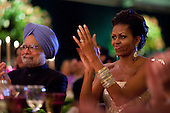 Washington, DC - November 24, 2009 -- First Lady Michelle Obama claps during the entertainment portion of the State Dinner for Prime Minister Manmohan Singh of India, left,  and his wife, Mrs. Gursharan Kaur, held in a tent on the South Lawn of the White House, November 24, 2009. .Mandatory Credit: Pete Souza - White House via CNP