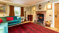 BNPS.co.uk (01202) 558833. <br /> Pic: Strutt&Parker/BNPS<br /> <br /> Sitting room with fireplace. <br /> <br /> Have Nessie for a neighbour...<br /> <br /> A beautifully-restored 19th century farmstead just minutes from Loch Ness with stunning Highland views is on the market for £675,000.<br /> <br /> The Steading is in the ancient village of Dores and has been lovingly restored and transformed to create a stylish yet cosy home.<br /> <br /> The house is just a few minutes' walk from the beach at Dores and on a clear day from the shore you can see all the way to the opposite end of the iconic loch - 25 miles away at Fort Augustus - which would be a perfect spot to hunt for its famous monster.<br /> <br /> The Steading would be an ideal property for someone looking for a peaceful, rural retreat in the Scottish Highlands, or could be a good investment property to rent out to holidaymakers.