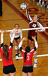 SIOUX FALLS, SD - OCTOBER 25:  Tagyn Larson #13 from Roosevelt tries to get a kill past Larissa Trainer #24 and Abigail Wahl #3 from Rapid City Central in the third game of their match Friday night at Roosevelt. (Photo by Dave Eggen/Inertia)