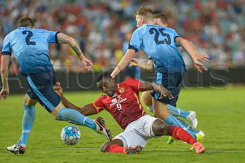 02.03.2016. Sydney, Australia. AFC Champions League. Sydney versus Guangzhou Evergrande. Evergrande forward Jackson Martinez is bundled over in the penalty area by Sydney defender Aaron Calver. Sydney won the game 2-1.