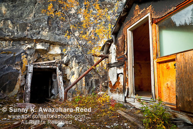 The remains of the abandoned Rambler Mine and shaft, Nabesna Road, Wrangell - St. Elias National Park & Preserve, Southcentral Alaska, Autumn.
