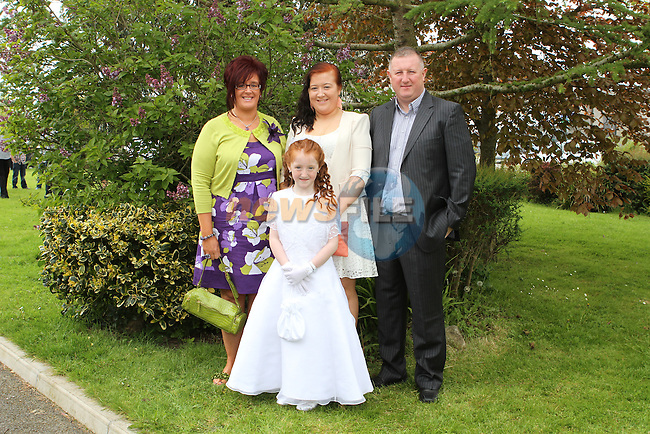Suranne Ellard with her family at the Communion in Holy Family Church...(Photo Jenny Matthews/www.newsfile.ie)