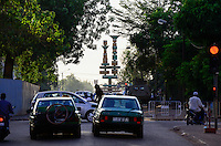 BURKINA FASO, capital Ouagadougou, traffic, roundabout place of cineasts, on the right patroling army tank / Kreisverkehr Platz der Cineasten, rechts Schuetzenpanzer der Armee