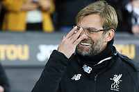 Liverpool manager Jurgen Klopp adjusts his glasses during the Premier League match between Swansea City and Liverpool at The Liberty Stadium, Swansea, Wales, UK. Monday 22 January 2018