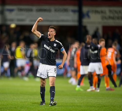 August 9th 2017, Dens Park, Dundee, Scotland; Scottish League Cup Second Round; Dundee versus Dundee United; Dundee captain Cammy Kerr celebrates at the final whistle in local derby
