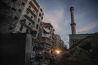 A Muslim mosque is viewed smashed among shattered buildings after an aircraft strike hits the mosque in Tarik Al-Bab neighborhood at the northeeast of Aleppo City.