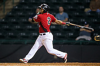 Eduard Pinto (2) of the Hickory Crawdads follows through on his swing against the Charleston RiverDogs at L.P. Frans Stadium on August 25, 2015 in Hickory, North Carolina.  The Crawdads defeated the RiverDogs 7-4.  (Brian Westerholt/Four Seam Images)
