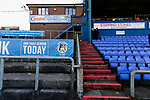 Early arrivals chatting in a sheltered corner of Boundary Park. Oldham v Portsmouth League 1