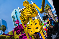 A Mexican man, having his face colorfully painted with skull, carries a large skeleton figure during the Day of the Dead festival in Mexico City, Mexico, 29 October 2016. Day of the Dead (Día de Muertos), a syncretic religious holiday combining the death veneration rituals of the ancient Aztec culture with the Catholic practice, is celebrated throughout all Mexico. Based on the belief that the souls of the departed may come back to this world on that day, people gather at the gravesites in cemeteries praying, drinking and playing music, to joyfully remember friends or family members who have died and to support their souls on the spiritual journey.