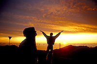 Visitors enjoy sunrise on Haleakala in Haleakala National Park.