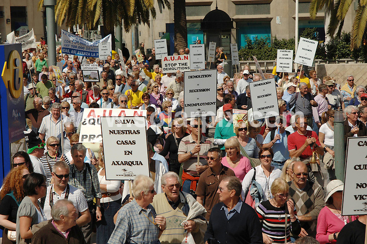 **ALL ROUND EXCLUSIVE PICTURES FROM SOLARPIX.COM**.**WORLDWIDE SYNDICATION RIGHTS**.Expats in Spain demonstrate in the centre of Malaga campaigning for the legalisation, and against demolition, of their homes. Around 1000 people marched through the main shopping street in the city, and then around the centre. Malaga, Spain. 17 March 2010.This pic: Malaga Expat March..JOB REF: 10911 IST     DATE: 17_03_2010.**MUST CREDIT SOLARPIX.COM OR DOUBLE FEE WILL BE CHARGED**.**MUST AGREE FEE BEFORE ONLINE USAGE**.**CALL US ON: +34 952 811 768 or LOW RATE FROM UK 0844 617 7637**