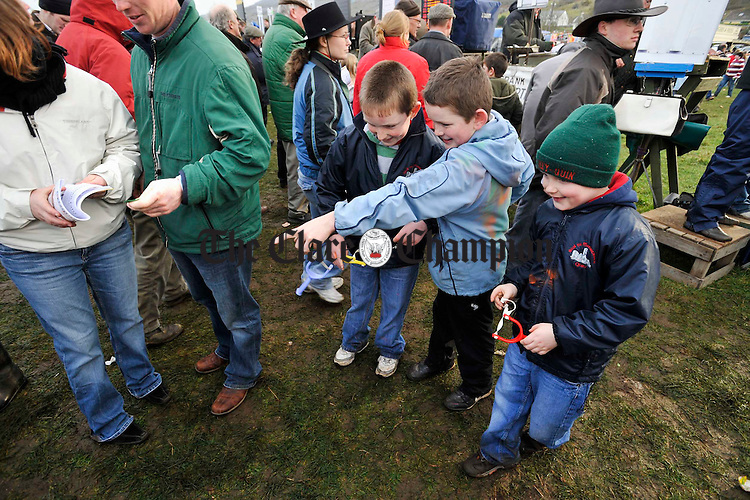 Young lads work their way through the crowd with their newly purchased catapults at the Point to Point in Bellharbour. Photograph by John Kelly.