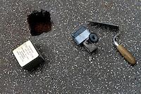 Roma, 12 Gennaio 2017<br /> L'artista tedesco Gunter Denming installa le pietre d'inciampo in Via Dei Lentuli al Quadraro davanti l'abitazione di Eldio Del Vecchio, arrestato il 17 Aprile 1944 e ucciso a Buchenvald <br /> <br /> Rome, January 12, 2017<br /> The German artist Gunter Denming installs the stumbling blocks in Via Dei Lentuli in Quadraro in front the home of partisan Eldio Del Vecchio arrested by the Nazi Gestapo on april 17, 1944 ,  killed in Buchenwald