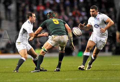 27.11.2010. Charlie Hodgson of England passes to Nick Easter of England.International Rugby England vs South Africa at Twickenham Stadium, England.