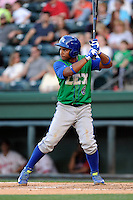 Second baseman Carlos Garcia (6) of the Lexington Legends bats in a game against the Greenville Drive on Thursday, April 24, 2014, at Fluor Field at the West End in Greenville, South Carolina. Greenville won, 9-4. (Tom Priddy/Four Seam Images)