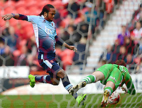 Doncaster Rovers' Marko Marosi saves at the feet of Blackpool's Nathan Delfouneso<br /> <br /> Photographer Chris Vaughan/CameraSport<br /> <br /> The EFL Sky Bet League Two - Doncaster Rovers v Blackpool - Keepmoat Stadium - Doncaster<br /> <br /> World Copyright &copy; 2017 CameraSport. All rights reserved. 43 Linden Ave. Countesthorpe. Leicester. England. LE8 5PG - Tel: +44 (0) 116 277 4147 - admin@camerasport.com - www.camerasport.com