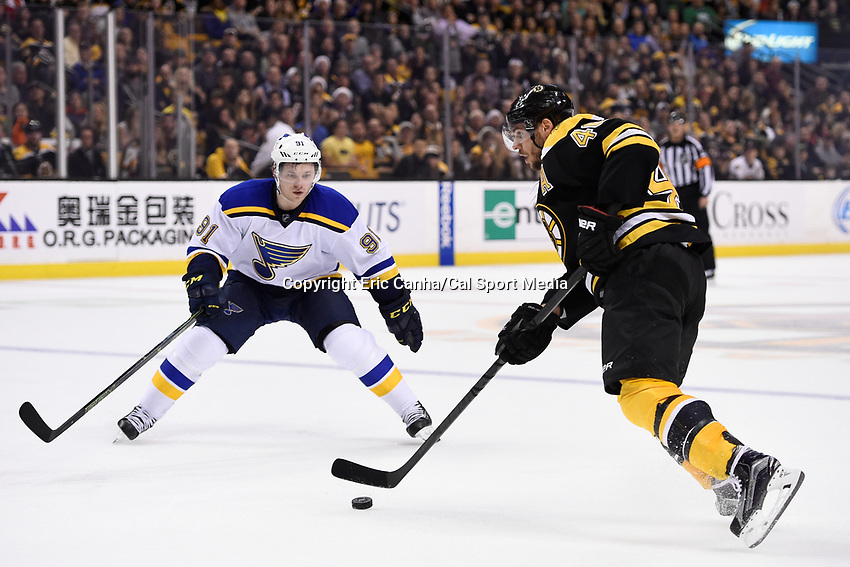 Tuesday, December 22, 2015: St. Louis Blues right wing Vladimir Tarasenko (91) tries to stop a shot by Boston Bruins center David Krejci (46)  during the National Hockey League game between the St. Louis Blues and the Boston Bruins held at TD Garden, in Boston, Massachusetts. The blues beat the Bruins 2-0 in regulation time. Eric Canha/CSM