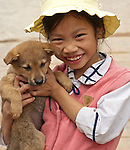 Vietnamese Girl 02 - Vietnamese girl with puppy.