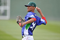 Starting pitcher Roniel Raudes (34) of the Greenville Drive warms up before a game against the Asheville Tourists on Sunday, April 10, 2016, at Fluor Field at the West End in Greenville, South Carolina. Greenville won 7-4. (Tom Priddy/Four Seam Images)
