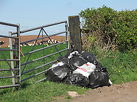Rubbish dumped in field gate Hanmer, Whitchurch, Shropshire.