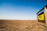 A sign along the Whitehorse Ranch Road in Southeast Oregon ironically warns the viewer to help prevent wildfires, as it stands alone in a completely desolate burned area.