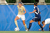 27 August 2011:  FIU's Chelsea Leiva (2) moves the ball upfield in the first half as the FIU Golden Panthers defeated the University of Arkon Zips, 1-0, at University Park Stadium in Miami, Florida.