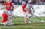 University at Albany Men's Lacrosse defeats Cornell 11-9 on Mar 4 at Casey Stadium.  Christian Knight misses on a save from Jakob Patterson's (#17) shot.