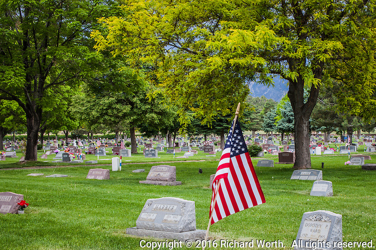 An American flag in a cemetery on Memorial Day weekend.