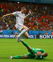 Fernando Torres of Spain hurdles over Netherlands goalkeeper Jasper Cillessen