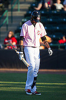 Jairo Beras (32) of the Hickory Crawdads walks back t the dugout after striking out against the Augusta GreenJackets at L.P. Frans Stadium on May 11, 2014 in Hickory, North Carolina.  The GreenJackets defeated the Crawdads 9-4.  (Brian Westerholt/Four Seam Images)