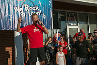 Olympic medalist, USA record-setter, and New York and Boston Marathon champion Meb Keflezghi is introduced to the crowd by Fleet Feet St. Louis owner David Spetnagel at the Fleet Feet Run with Meb event at the Des Peres store, Wednesday, September 3, 2014.