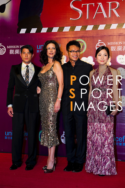 HAIKOU, CHINA - OCTOBER 29:  (L-R) Hong Kong actor Aaron Kwok, Hollywood actress Catherine Zeta-Jones, Vice Chairman of Mission Hills Group Dr. Ken Chu and his wife Audrey Chu attend red carpet during day three of the Mission Hills Start Trophy tournament at Mission Hills Resort on October 29, 2010 in Haikou, China.  Photo by Victor Fraile / The Power of Sport Images