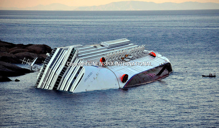 "Isola del Giglio, Italy_15/01/2012:  COSTA CONCORDIA RUNS AGROUND.The Costa Concordia, which was carrying more than 4,000 passengers, experienced trouble a few hundred metres from the tiny Tuscan holiday island of Giglio on Friday evening as the passengers were at dinner, after apparently sailing off course.Desperate passengers scrambled to evacuate the stricken vessel as it began to take on water and list to the right, with some opting to jump into the sea..A massive coastguard rescue operation involving helicopters and rescue boats was immediately launched.At daybreak, the ship could be seen almost completely on its side..Mandatory Credit Photo: ©Bramo-Sestini/NEWSPIX INTERNATIONAL..**ALL FEES PAYABLE TO: ""NEWSPIX INTERNATIONAL""**..IMMEDIATE CONFIRMATION OF USAGE REQUIRED:.Newspix International, 31 Chinnery Hill, Bishop's Stortford, ENGLAND CM23 3PS.Tel:+441279 324672  ; Fax: +441279656877.Mobile:  07775681153.e-mail: info@newspixinternational.co.uk"