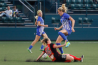 Rochester, NY - Friday May 27, 2016: Boston Breakers defender Kassey Kallman (5) jumps over Western New York Flash forward Meredith Speck (25). The Western New York Flash defeated the Boston Breakers 4-0 during a regular season National Women's Soccer League (NWSL) match at Rochester Rhinos Stadium.