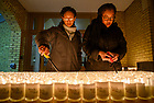 January 19, 2020; Students Ashley Lizana and MacKenzie Isaac light the candles before the MLK Candlelight Prayer Service in Main Building.  (Photo by Barbara Johnston/University of Note Dame)