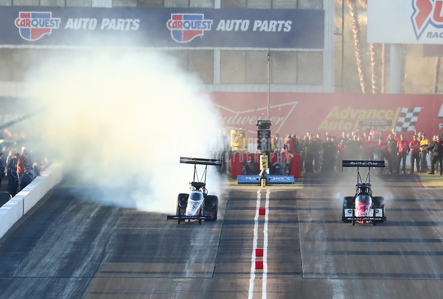 Feb 23, 2019; Chandler, AZ, USA; NHRA top fuel driver Austin Prock (left) goes sideways alongside Clay Millican during qualifying for the Arizona Nationals at Wild Horse Pass Motorsports Park. Mandatory Credit: Mark J. Rebilas-USA TODAY Sports