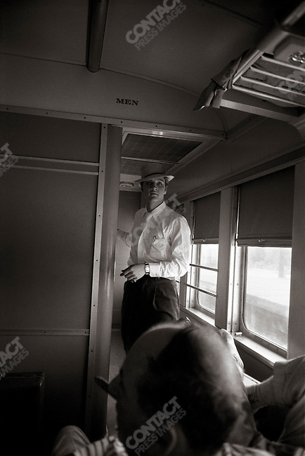 On a train somewhere between Chatanooga and Memphis on the Southern Railroad, part of a 27-hour overnight train trip. USA. Early July 4, 1956