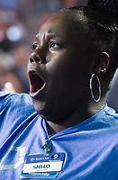 NWA Democrat-Gazette/CHARLIE KAIJO A Walmart associate reacts during the Walmart shareholders meeting, Friday, June 7, 2019 at the Bud Walton Arena in Fayetteville.