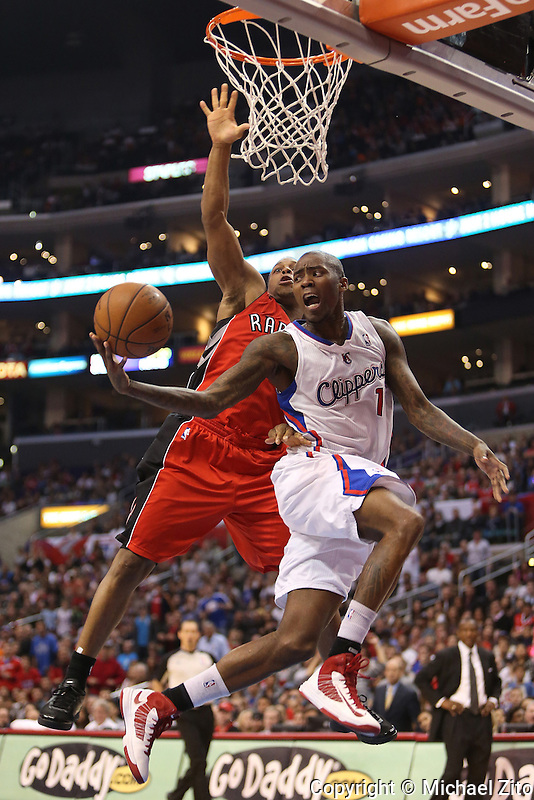 12/09/12 Los Angeles, CA: Los Angeles Clippers shooting guard Jamal Crawford #11 and Toronto Raptors point guard Kyle Lowry #3 during an NBA game between the Los Angeles Clippers and the Toronto Raptors played at Staples Center. The Clippers defeated the Raptors 102-83.