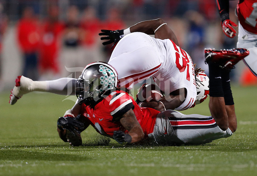 Ohio State Buckeyes cornerback Bradley Roby (1) takes out Wisconsin Badgers running back Melvin Gordon (25) at the knees in the first quarter of the NCAA football game at Ohio Stadium in Columbus, Saturday evening, September 28, 2013. As of halftime the Ohio State Buckeyes led the Wisconsin Badgers 24 - 14. (Columbus Dispatch  / Eamon Queeney)