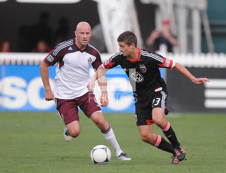 D.C. United midfielder Perry Kitchen (23) goes against Colorado Rapids forward Conor Casey (9) D.C. United defeated the Colorado Rapids 2-0 at RFK Stadium, Wednesday May 16, 2012.