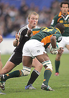 New Zealand flanker Luke Baird puts South African full back Wilton Pietersen under pressure during the U19 Championship final against South Africa at Ravenhill, Belfast.