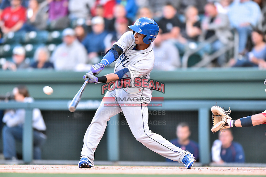 Asheville Tourists third baseman Jonathan Piron (9) swings at a pitch during a game against the Greenville Drive at Fluor Field on April 7, 2016 in Greenville South Carolina. The Drive defeated the Tourists 4-3. (Tony Farlow/Four Seam Images)
