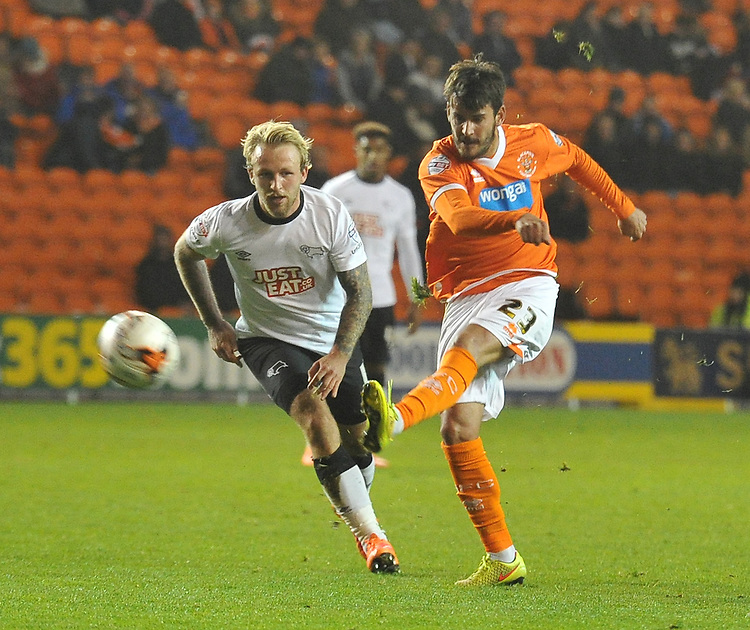 Blackpool's Edu Oriol fires in a shot past Derby County's Johnny Russell<br /> <br /> Photographer Dave Howarth/CameraSport<br /> <br /> Football - The Football League Sky Bet Championship - Blackpool v Derby County - Tuesday 21st October 2014 - Bloomfield Road - Blackpool<br /> <br /> &copy; CameraSport - 43 Linden Ave. Countesthorpe. Leicester. England. LE8 5PG - Tel: +44 (0) 116 277 4147 - admin@camerasport.com - www.camerasport.com