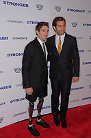 www.acepixs.com<br /> <br /> September 14 2017, New York City<br /> <br /> Jeff Bauman (L) and actor Jake Gyllenhaal arriving at the premiere of 'Stronger'  at the Walter Reade Theater on September 14, 2017 in New York City.<br /> <br /> By Line: Curtis Means/ACE Pictures<br /> <br /> <br /> ACE Pictures Inc<br /> Tel: 6467670430<br /> Email: info@acepixs.com<br /> www.acepixs.com