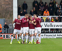 5th January 2020; Pirelli Stadium, Burton Upon Trent, Staffordshire, England; English FA Cup Football, Burton Albion versus Northampton Town; Nicholas Adams of Northampton Town celebrates with his team after scoring in the 10th minute 0-1 - Strictly Editorial Use Only. No use with unauthorized audio, video, data, fixture lists, club/league logos or 'live' services. Online in-match use limited to 120 images, no video emulation. No use in betting, games or single club/league/player publications